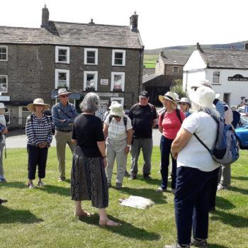 Helen Bainbridge addressing the group on Reeth Green [Margaret Atherden]