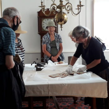 Helen showing exhibits from Museum [Margaret Atherden]