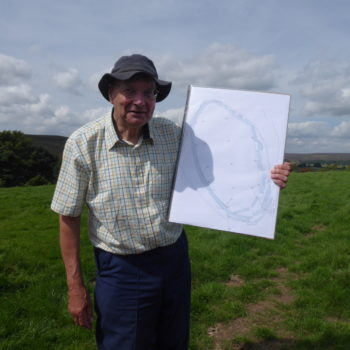 Roger Inman with plan of site [Margaret Atherden]